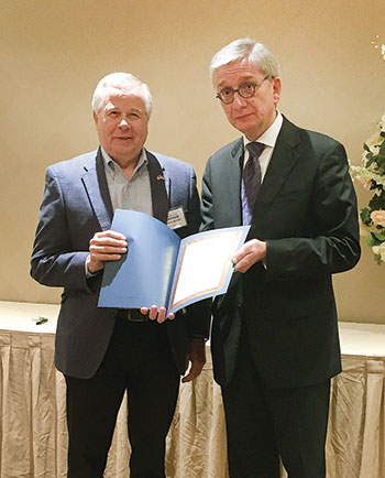 """Eugene Czolij (right), president of the Ukrainian World Congress, honors SUMA Yonkers Federal Credit Union with an award """"For very significant financial support"""" to the UWC.  Accepting the award is SUMA FCU Chairman Andrew Horbachevsky, newly elected chairman of the Ukrainian National Credit Union Association."""