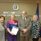At the Macomb County awards ceremony recognizing community volunteers, (from left) are: Marta Kwitkowsky, honoree Marie Zarycky-Cherviovskiy, Macomb County Commissioner Andrey Duzyj; Nadia Purnell and Catherine Kizyma, president of Ukrainian National Women's League of America Branch 96.