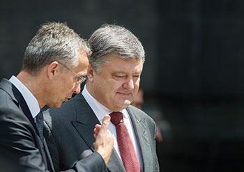 NATO Secretary-General Jens Stoltenberg speaks with President Petro Poroshenko of Ukraine in Kyiv.