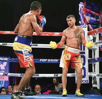 Vasyl Lomachenko (right) taunts Miguel Marriaga from the corner.