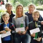 Women's finalist Lesia Bilak Schinnerer with her sons (from left), Erik (finalist) and Kase (winner) in the boys' group with USCAK Tennis Committee member Ivan Durbak (left) and USCAK Tennis Director Yurko Sawchak.