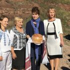 Holly Palance holds the ritual bread with which she was greeted in her ancestral village of Ivane-Zolote, Ternopil Oblast, with her cousin Lida Palahniuk (second from left), the local school's principal (right) and a schoolteacher (left).