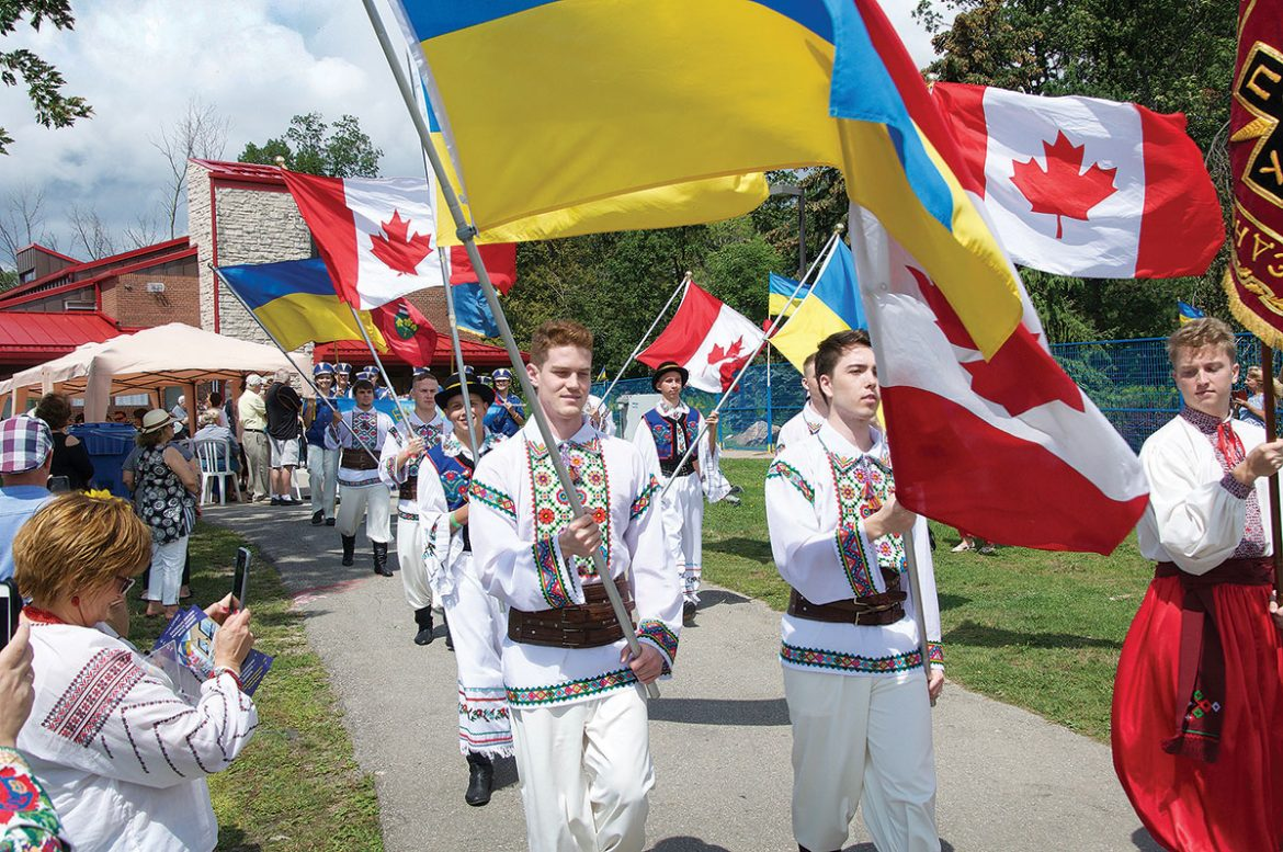 Flag-bearers in Centennial Park for Toronto's Ukrainian Independence Day celebration, which also marked the 150th anniversary of Canada.