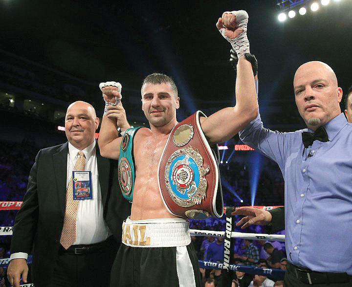 Light heavyweight Oleksandr Gvozdyk celebrates his double wins for the light heavyweight titles of the North American Boxing Federation and the North American Boxing Organization.
