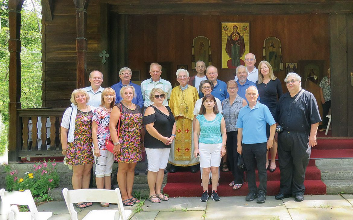 Club Suzie-Q members and Father George Bazylevsky at the Soyuzivka chapel after a service in memory of the late Taras Dobusz.