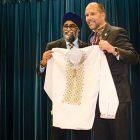 Ukrainian Canadian Congress National President Paul Grod presents a Ukrainian embroidered shirt to Canada's National Defense Minister Harjit S. Sajjan.