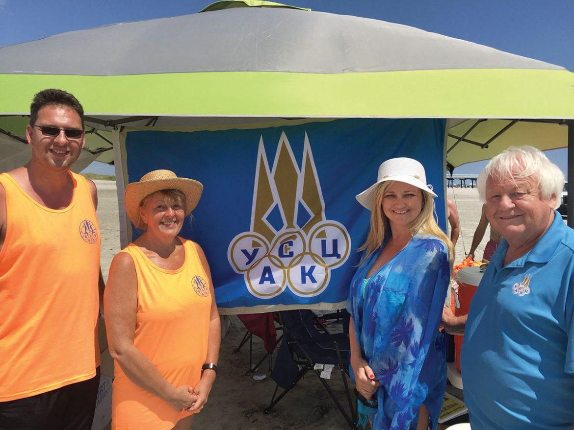 At the beach volleyball tournament (from left) are: Roman Bulawski, tournament organizer; Mary Kolodij, director and president, and Oxana Holubowsky, treasurer, both of Ukrainian Selfreliance Federal Credit Union, a sponsor of the tournament; and Myron Bytz, president of the Ukrainian Sports Federation of the U.S.A. and Canada.