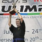 Peter Fil celebrates his win in Haidong Gumdo with the first place World Mulimpia trophy.