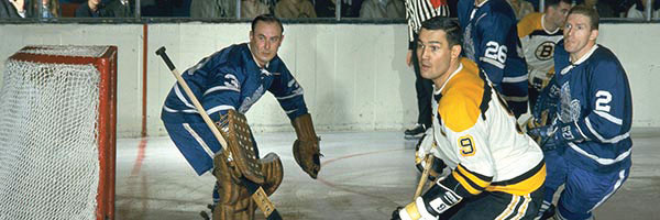 """Johnny """"Chief"""" Bucyk awaits a pass in front of the net against the Toronto Maple Leafs, during the early days of his career."""