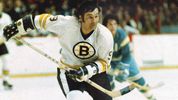 Johnny Bucyk chases the puck down the ice during the later years of his career.