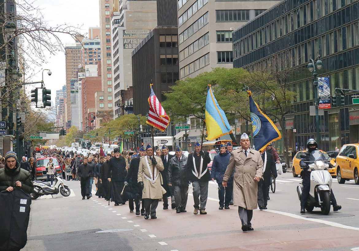 Ukrainian American Veterans lead the solemn march from St. George Ukrainian Catholic Church to St. Patrick's Cathedral.