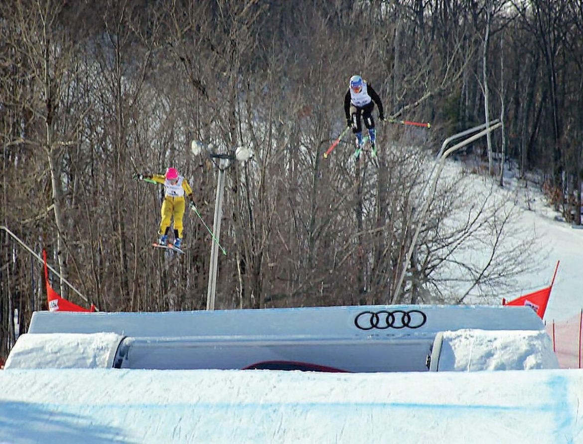 Tania Prymak soars above her competition at a World Cup Ski Cross event at Blue Mountain in Ontario, Canada.