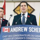 Opposition Leader Andrew Scheer (at podium) with Member of Parliament James Bezan, both members of the Conservative Party of Canada.