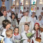 Bishop Danylo is greeted as he enters Assumption of the Blessed Virgin Mary Ukrainian Catholic Church in Miami.