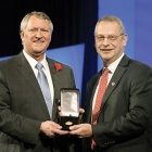 Dr. Boris Lushniak (right) receives the AMA Distinguished Service Award from AMA President David O. Barbe, M.D.