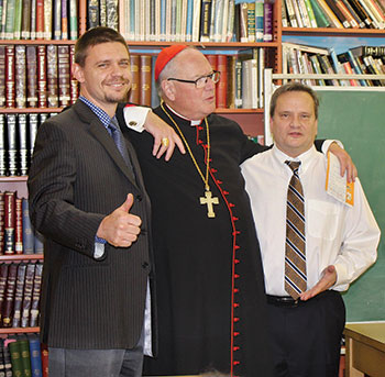 Duirng the cardinal's visit to St. George Academy (from left) are: Vitaly Kit, religion teacher, Cardinal Timothy Dolan and Andrew Stasiw, SGA principal.