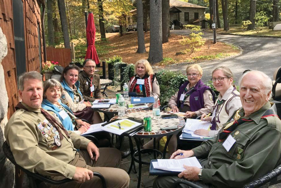 Taking advantage of a beautiful day at Soyuzivka, members of the Plast by-laws committee meet outside.