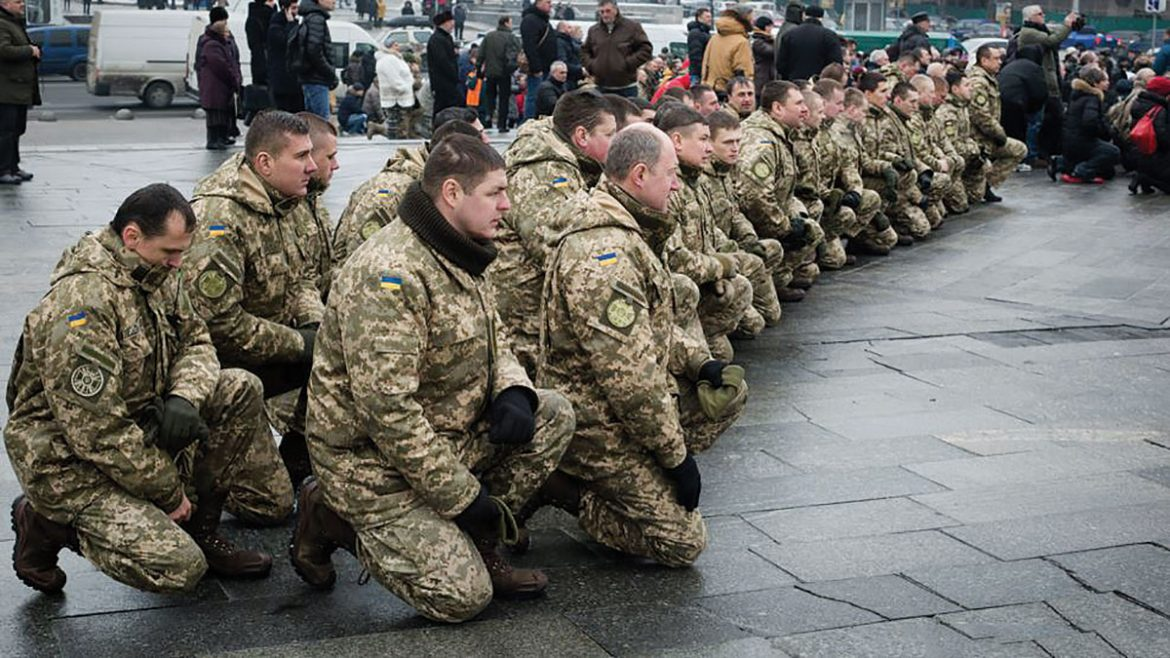 In Kyiv on February 1, Ukrainian soldiers pray for their comrades-in-arms killed in the Russian offensive on Avdiyivka.