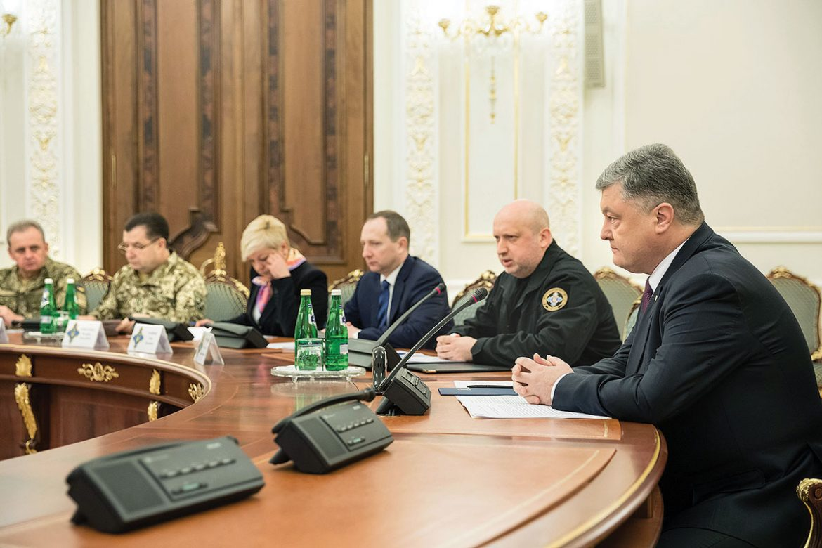 President Petro Poroshenko (right) and National Security and Defense Council Secretary Oleksandr Turchynov (second from right) at the council's meeting on March 15, when a decision was made to halt all cargo traffic with the occupied Donbas.