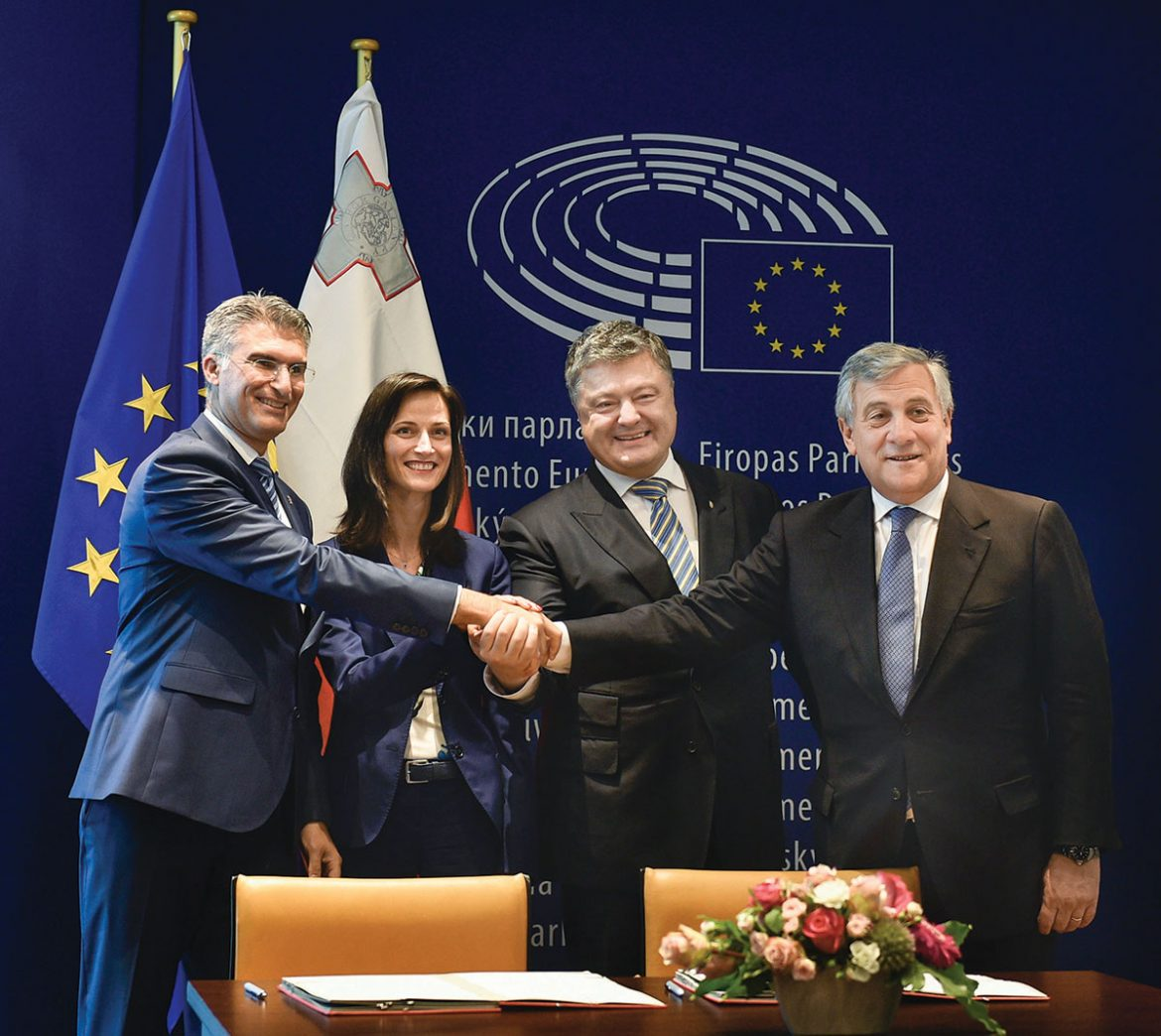 At the signing ceremony for a new visa-liberalization regime with the European Union in Strasbourg on May 17 (from left) are: Malta's Interior Minister Carmelo Abela (whose country then held the rotating presidency of the EU), Member of the European Parliament Mariya Gabriel, Ukraine's President Petro Poroshenko and European Parliament President Antonio Tajani. In his May 14 press conference, Mr. Poroshenko cited Ukraine's closer ties with the European Union as a major achievement.