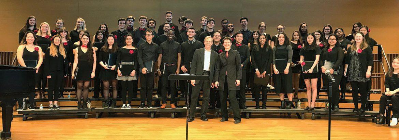 Composer Alexander Kuzma and choral director Nadya Potemkina pose with Wesleyan Concert Choir following the concert on November 19, 2017.