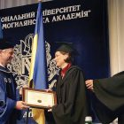 Dr. Andriy Meleshevych, president of the National University of Kyiv-Mohyla Academy, bestows an honorary doctorate on Anne Applebaum.