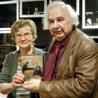 """Director Yurij Luhovy and Lana Babij, member of the Connecticut Holodomor Committee, hold the newly released Ukrainian educational version of """"Okradena Zemlya."""""""