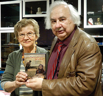"Director Yurij Luhovy and Lana Babij, member of the Connecticut Holodomor Committee, hold the newly released Ukrainian educational version of ""Okradena Zemlya."""
