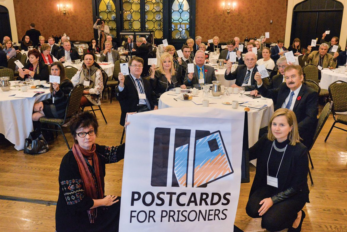 Participants of the conference in Toronto with postcards for Ukrainian political prisoners.