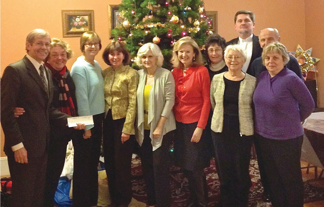 Friends of UCU-Boston Branch present the Ukrainian Catholic Education Foundation's chief fund-raiser, Alex Kuzma, with a $3,000 check.