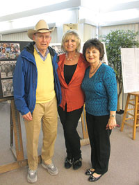 Following the February 24 lecture on Ukraine at the Longboat Key Education Center, speaker Anisa Mycak (right) poses with the center's executive director, Susan Goldfarb (center), and an audience member sporting the blue and yellow colors of Ukraine's flag.