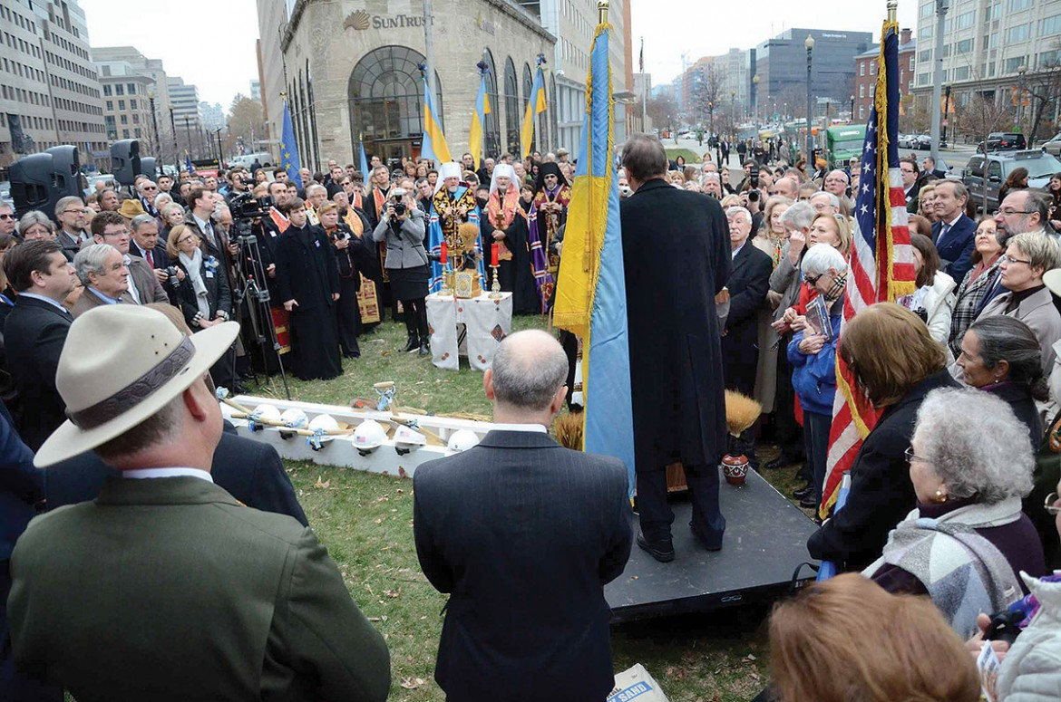 The crowd of Ukrainian Americans and others who came to Washington on December 4 to witness the groundbreaking ceremony of the Ukrainian Holodomor Memorial listen to one of the dignitaries speak.