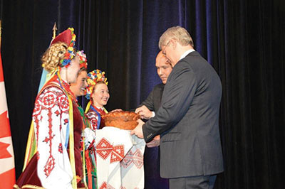 Prime Minister Stephen Harper of Canada (foreground) and Ukrainian Canadian Congress National President Paul Grod are greeted by the Barvinok Ukrainian Dance Group at the XXIV triennial Congress of Ukrainian Canadians, which was held on November 8-10.