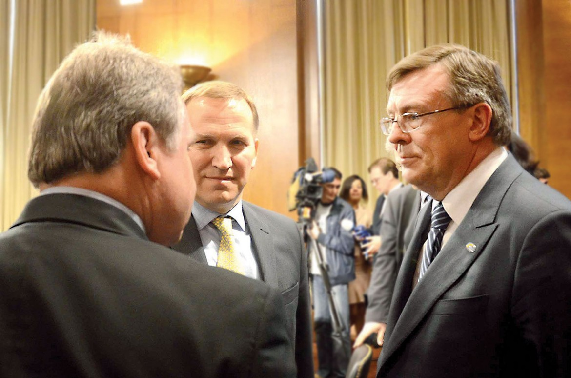 Ukrainian Foreign Affairs Minister Leonid Kozhara (right) in discussion with Rep. Christopher Smith (R-N.J.), the co-chairman of the U.S. Helsinki Commission, at the conclusion of his testimony before the commission on May 8. Standing next to him is Ukraine's Ambassador to the U.S. Olexander Motsyk.