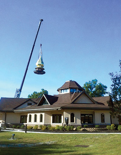 A crane lifts the main cupola for placement atop St. John the Baptist Ukrainian Catholic Church in Whippany, N.J., on September 20, one day before the new church was consecrated.