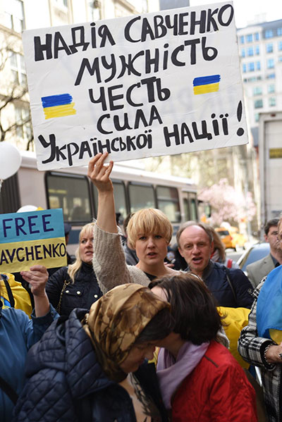 """A rally participant's sign reads: """"Nadiya Savchenko: courage, honor, strength of the Ukrainian nation."""""""