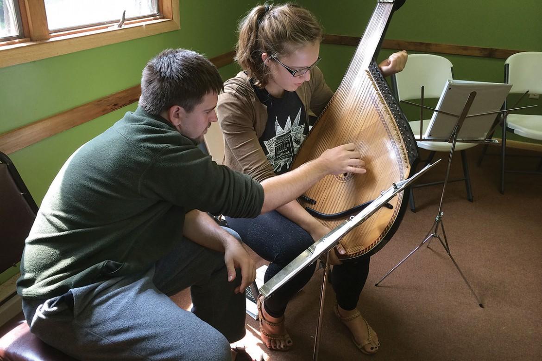 Instructor Borys Ostapienko helps Roxolana Shepko.