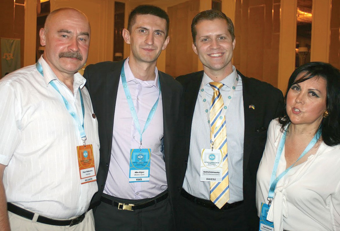 Meeting during the congress (from left) are: Piotr Hlebowicz, Alim Aliyev, Andrij Dobriansky and Ayla Bakkalli, U.S. representative of the Crimean Tatar Mejlis.