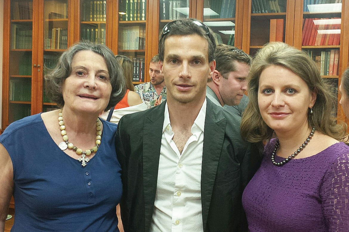 Prof. Anna Procyk (left) and Karina Tarnawsky (right), board members of the Shevchenko Scientific Society, with Roman Torgovitsky during the reception that followed the forum on the humanitarian crisis in Ukraine.