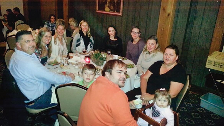 Enjoying dinner in Soyuzivka's dinning room (clockwise from left) are: Don McCarthy, Maya Lew, Larissa Zinycz, Alexa Kryzaniwsky, Nadia Kihiczak, Lidia Kekis, Adrianna Melnyk Hankewycz, and the Cade family: Kristine, Olya, Andrij and Myron.
