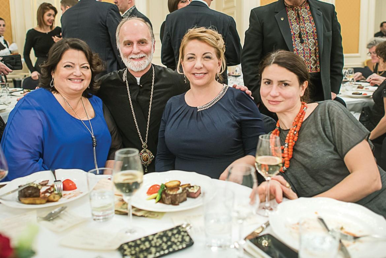 Bishop Borys Gudziak joins (from left) Lydia Matiaszek, Kateryna Yushchenko and Maryna Antonova at the UCU benefit.