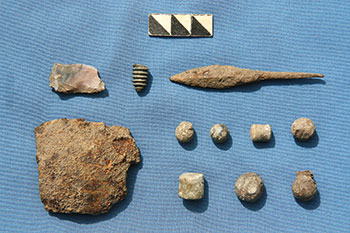 Flint and bronze screw from a rifle, an iron arrowhead, a splinter from an iron cannonball and lead musket bullets, pre-1708, from excavations of the military barracks at Mazepa's manor in 2013. (Photo by Volodymyr Mezentsev.)