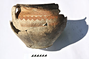 Restored 17th-18th century pot, decorated with an ochre design, from excavations near the cemetery of the Trinity Cathedral in 2013. (Photo by Volodymyr Mezentsev.)