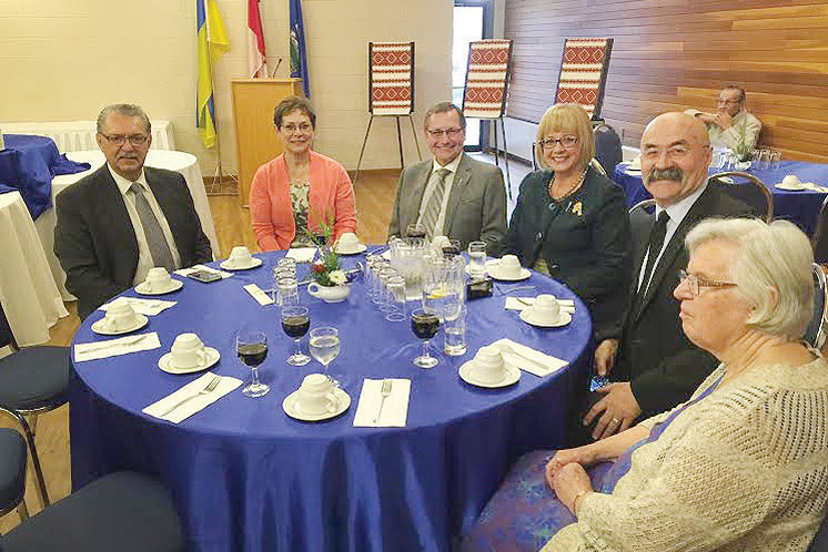 Seated (from left) are: Gene Zwozdesky, Marie and Ed Stelmach, Janice and Steve Sarich, and Motria Dackiw.