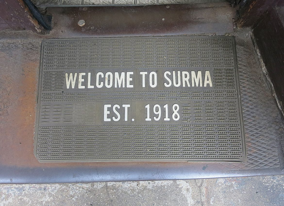 The welcome mat outside of the Surma shop.