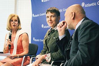 Paula J. Dobriansky (left), an Atlantic Council board director, introduces Nadiya Savchenko (center) at an Atlantic Council event in Washington on September 22. On the right is Ms. Savchenko's interpreter, Alexei Sobchenko.