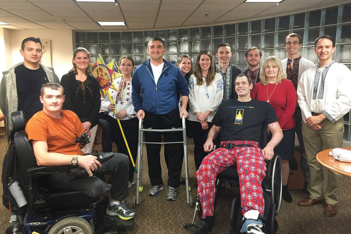 Members of Plast Ukrainian Scouting Organization and the Ukrainian American Youth Association visited with and sang Christmas carols for Ukraine's wounded warriors who were receiving treatment at Walter Reed National Military Medical Center in Bethesda, Md., on January 10.