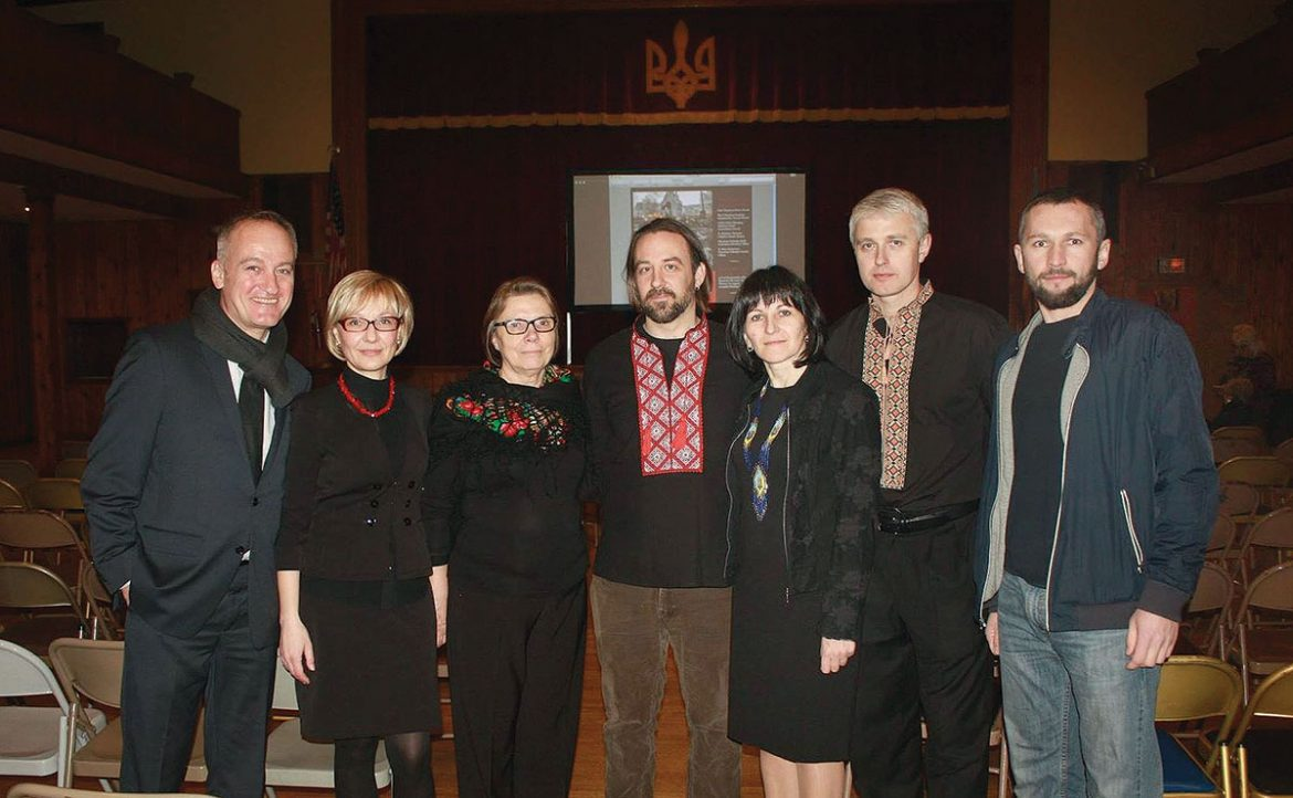 """Damian Kolodiy's film """"Freedom or Death"""" was screened on February 4 at the Ukrainian Center in Passaic, N.J., as part of a commemorative evening marking the second anniversary of the sacrifices made by the Heavenly Brigade. Mr. Kolodiy (center) is seen here with community activists and the event's organizers."""