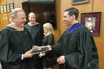 Jonathan Peri, the new president of Manor College, is pictured with Manor College Board of Trustees Chair Leonard Mazur before his inauguration on April 21.