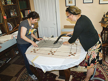 """When the Costume Society of America held its annual meeting this year in Cleveland on May 24-29, it chose for its """"CSA Angels Project"""" the Ukrainian Museum-Archives. Seven college professors, four professional textile conservators and more than a dozen volunteers came to the UMA to clean, catalogue and place more than 300 items into acid-free storage boxes."""